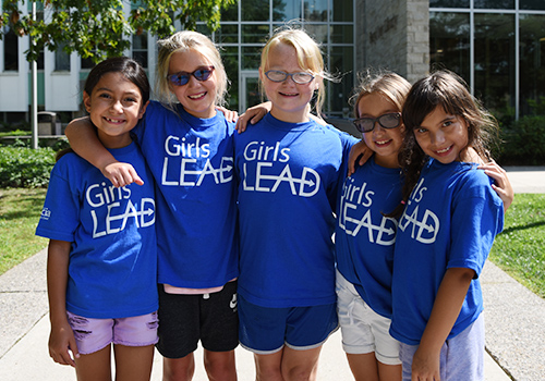 Group of girls wearing BresicaLEAD t-shirts
