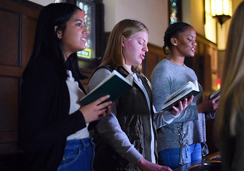 Student choir singing in the Chapel