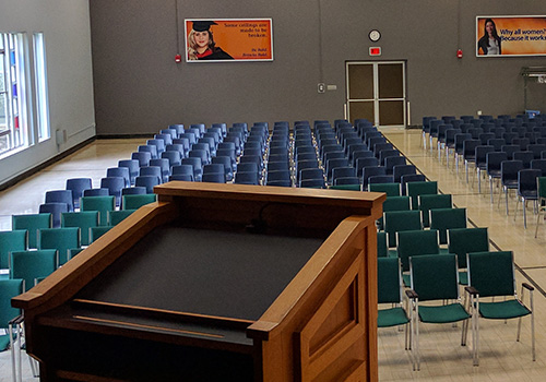 Auditorium with chairs at Brescia