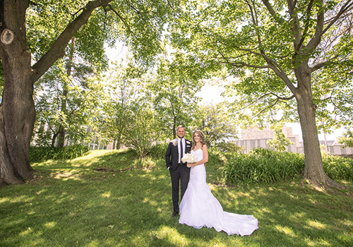 Couple in front of trees