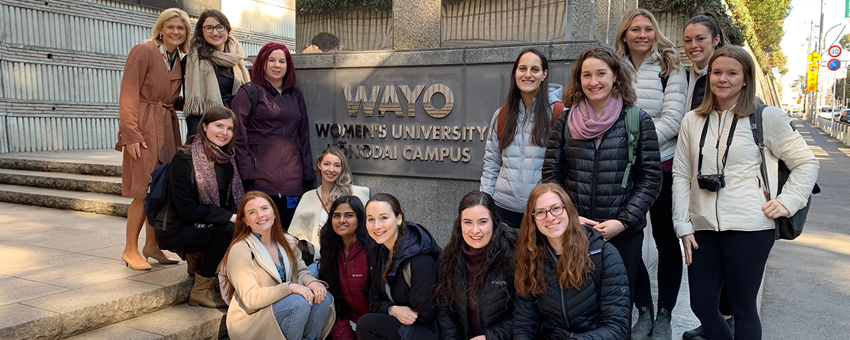 Students standing by the WAYO sign in Japan