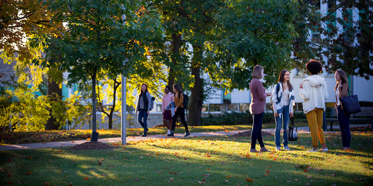 Students walking through Bresica's campus