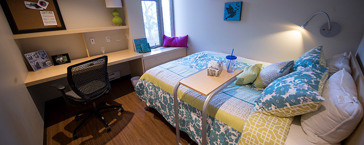 Residence room with queen sized bed and desk