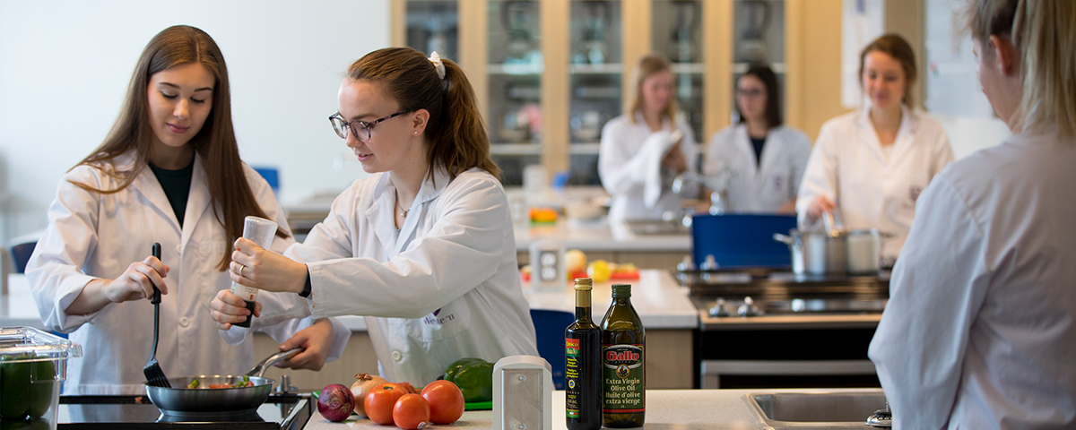 Students cooking in the food labs at Brescia