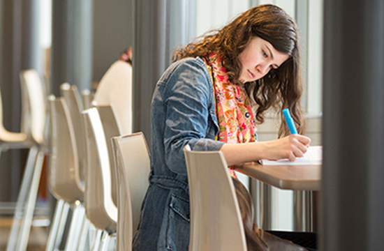 Student working at a table