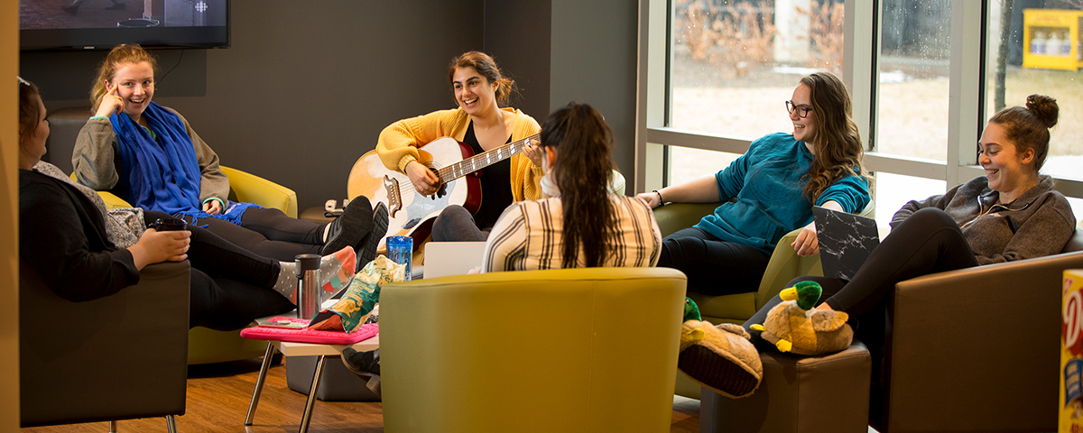 Students relaxing in a residence lounge.
