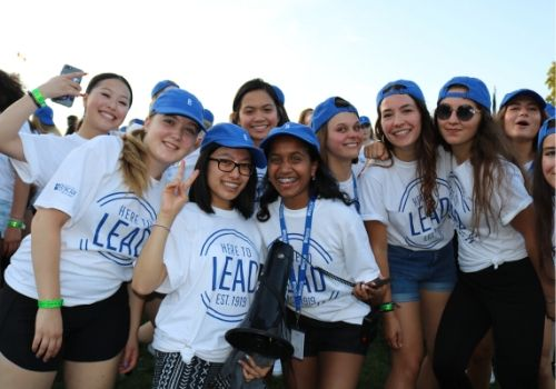New-to-Brescia students wearing their Brescia tshirts and hats at Orientation Week event.